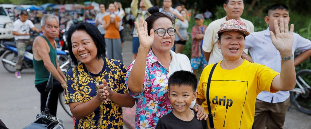PHOTO: Onlookers wave as an ambulance carrying rescued schoolboys leaves a military airport in Chiang Rai, Thailand, July 10, 2018.