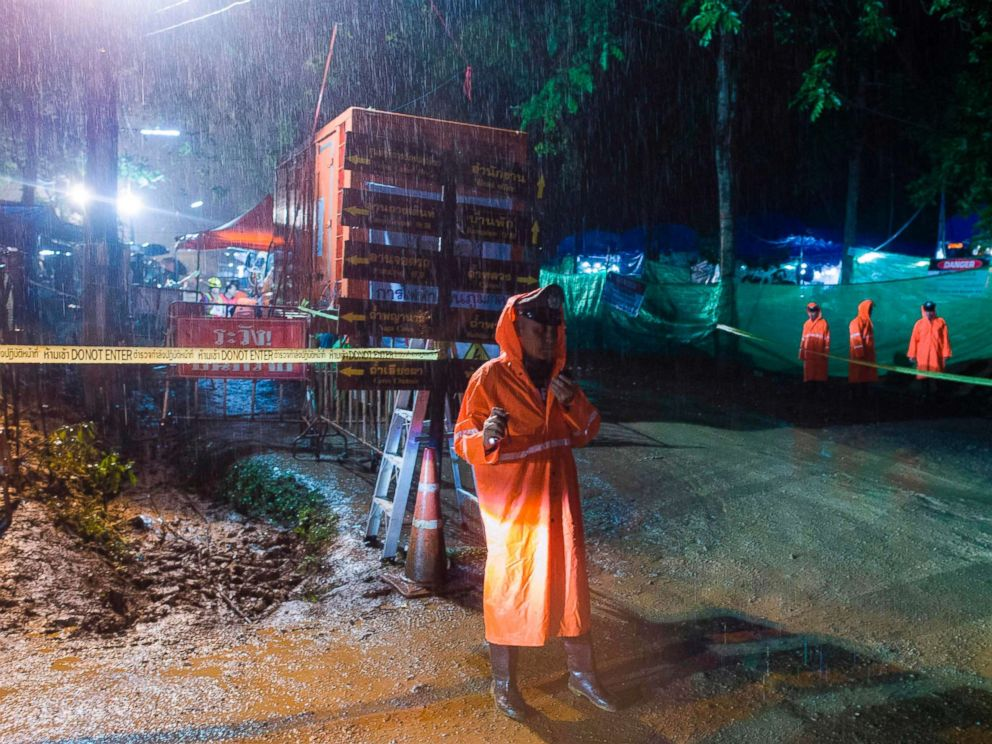 PHOTO: A Thai policeman guards an area under rainfall near the Tham Luang cave at the Khun Nam Nang Non Forest Park in Mae Sai district of Chiang Rai province, July 7, 2018, as rescue operation continues for the 12 boys and their football team coach.