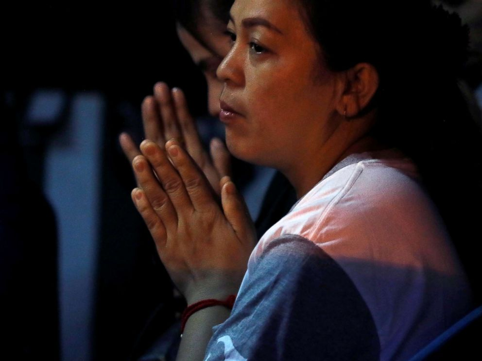 PHOTO: A family member prays near the Tham Luang cave complex, where 12 schoolboys and their soccer coach are trapped inside a flooded cave, in the northern province of Chiang Rai, Thailand, July 7, 2018.