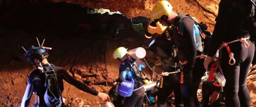 PHOTO: Thai rescue team members walk inside a cave where 12 boys and their soccer coach have been trapped since June 23, in Mae Sai, Chiang Rai province, northern Thailand in this undated photo released by Royal Thai Navy, July 7, 2018.