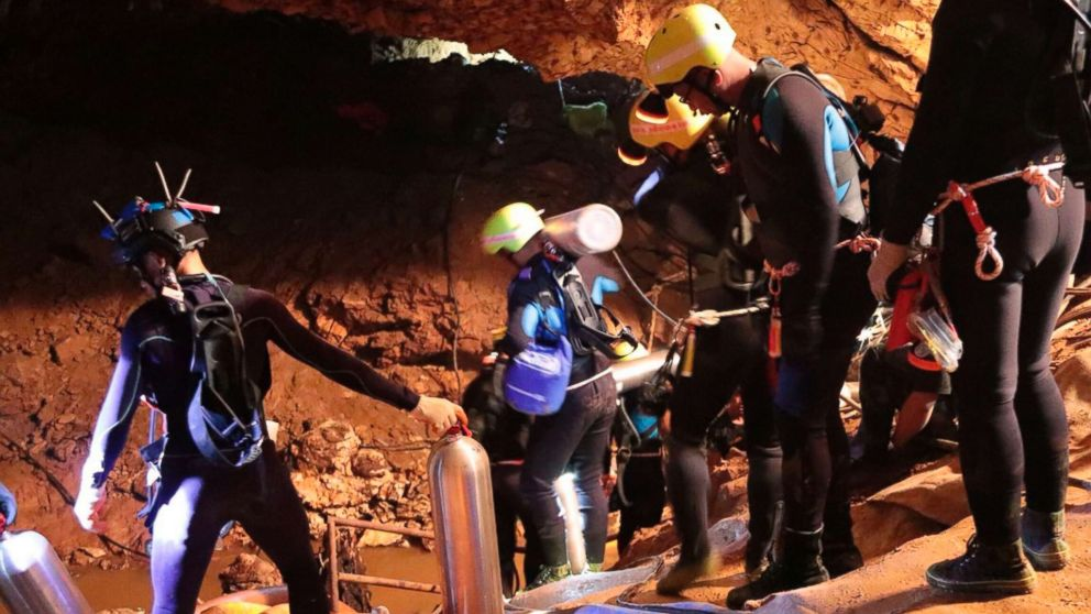 Thai rescue team members walk inside a cave where 12 boys and their soccer coach have been trapped since June 23, in Mae Sai, Chiang Rai province, northern Thailand in this undated photo released by Royal Thai Navy, July 7, 2018.