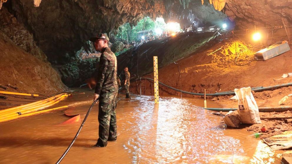 Thai rescue teams arrange a water pumping system at the entrance to a flooded cave complex where 12 boys and their soccer coach have been trapped since June 23, in Mae Sai, Chiang Rai province, northern Thailand in this undated photo released by Royal Thai Navy, July 7, 2018.