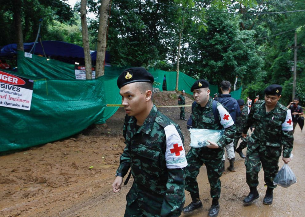 PHOTO: Thai military medical personnel take part in preparations during the ongoing rescue operation for the boys soccer team and their assistant coach to exit the cave at Tham Luang cave in Khun Nam Nang Non Forest Park, July 8, 2018 in Thailand.