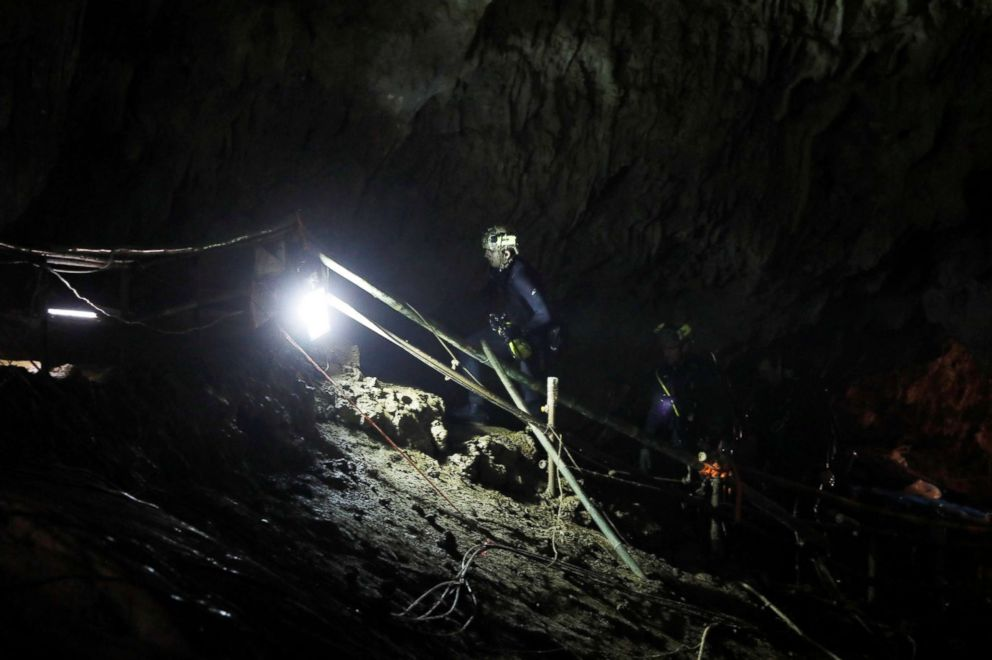PHOTO: Divers walk inside Tham Luang cave complex, where 12 schoolboys and their soccer coach are trapped inside a flooded cave, in the northern province of Chiang Rai, Thailand, July 7, 2018.