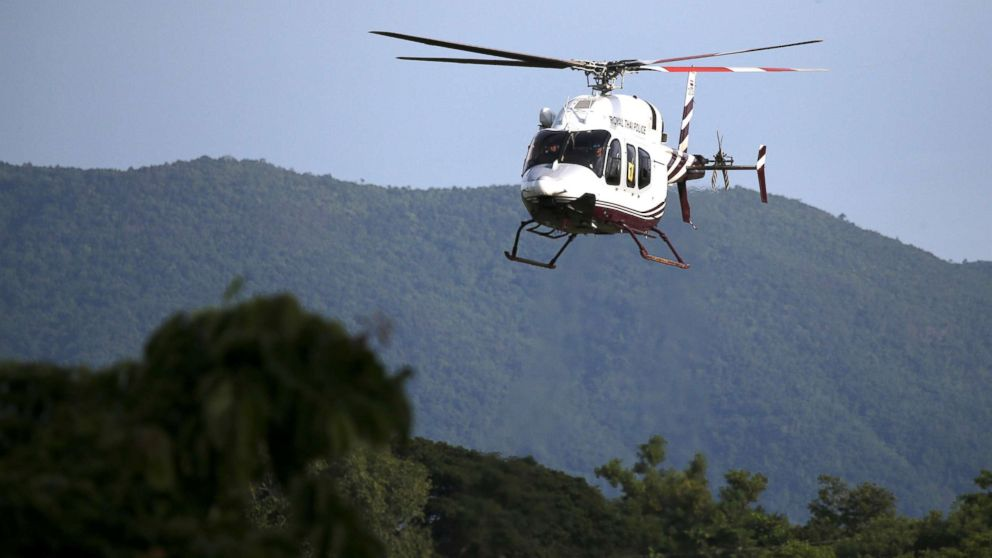 A military helicopter carrying rescued schoolboys approaches to land at a military airport in Chiang Rai, Thailand, July 9, 2018.