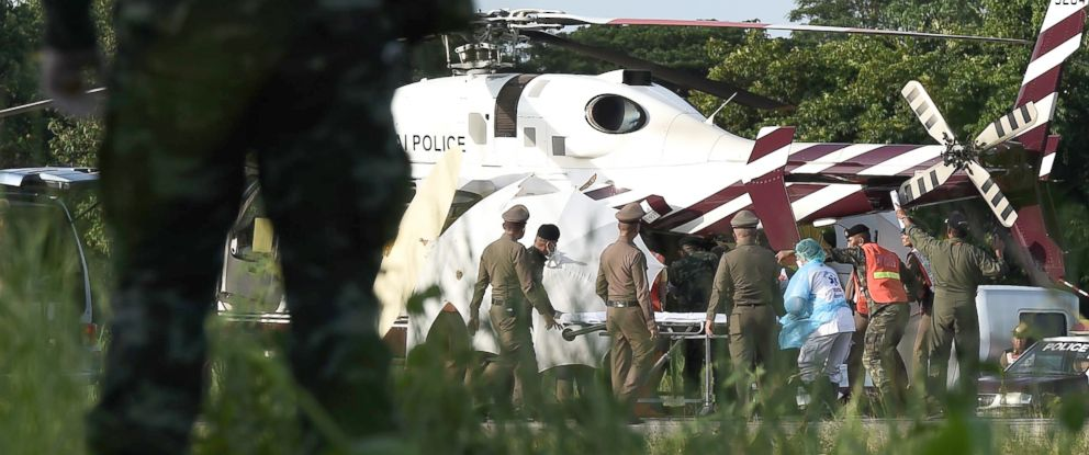 PHOTO: Rescue workers bring a stretcher close to a police helicopter at a military airport in Chiang Rai on July 9, 2018, as rescue operations continue for those still trapped inside the cave in Khun Nam Nang Non Forest Park in the Mae Sai district.