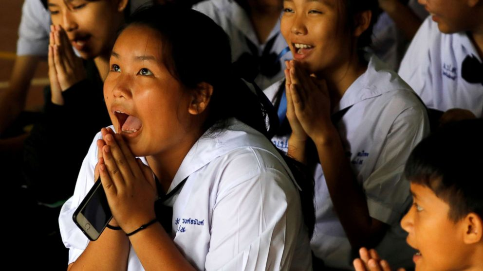 Classmates react after a teacher announces that some of the 12 schoolboys who were trapped inside a flooded cave, have been rescued, at Mae Sai Prasitsart school,  in the northern province of Chiang Rai, Thailand, July 9, 2018.
