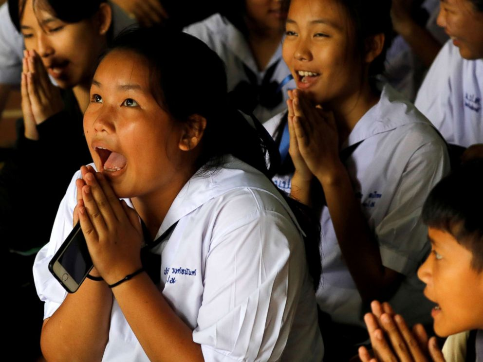 PHOTO: Classmates react after a teacher announces that some of the 12 schoolboys who were trapped inside a flooded cave, have been rescued, at Mae Sai Prasitsart school, in the northern province of Chiang Rai, Thailand, July 9, 2018.