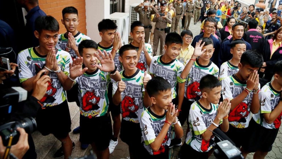 The 12 boys and their soccer coach who were rescued from a flooded cave arrive for a news conference in the northern province of Chiang Rai, Thailand, July 18, 2018.