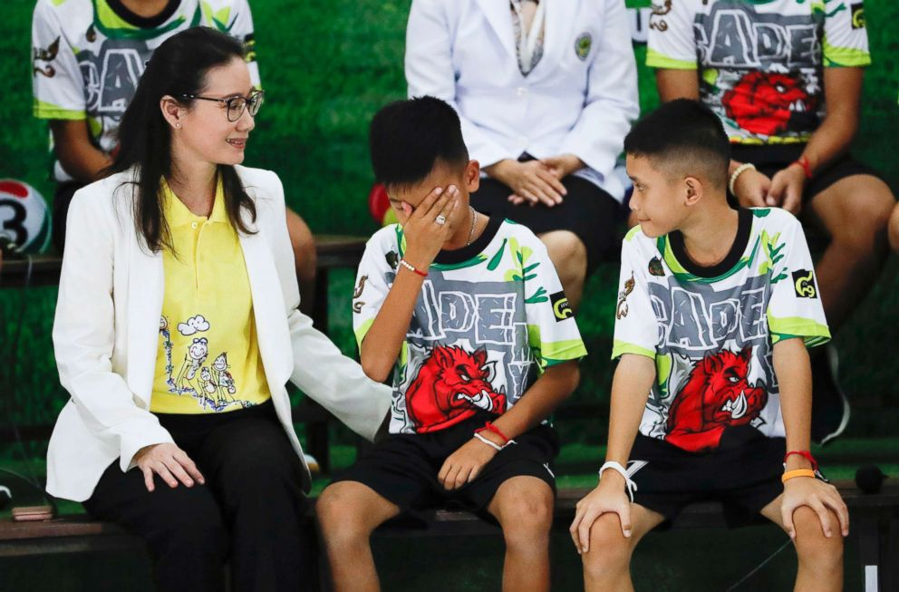 """Rescued soccer player """"Titan"""" Chanin Vibulrungruang reacts after paying respect to a portrait of Saman Gunan, the Thai Navy SEAL diver who died in the rescue attempt, during a press conference discussing their ordeal in Chiang Rai, northern Thailand, July 18, 2018."""