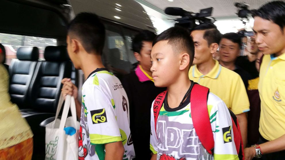 Two of the twelve rescued members of the Wild Boar soccer team depart from the Chiangrai Prachanukroh Hospital in Chiang Rai province, Thailand, July 18, 2018.