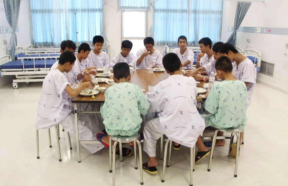 Some of the rescued soccer team members eat a meal together at a hospital in Chiang Rai, northern Thailand, July 15, 2018.