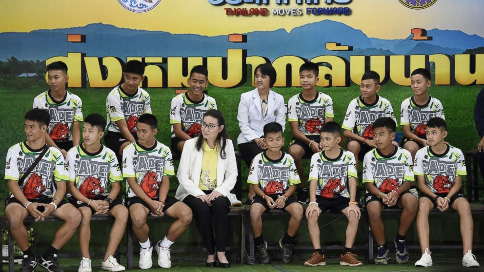 Twelve Thai boys and their football coach, rescued from a flooded cave after being trapped, attend a press conference in Chiang Rai, July 18, 2018, following their discharge from the hospital.