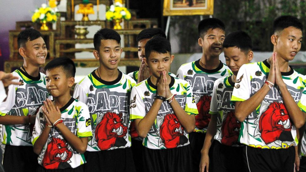 Some of the 12 members of the Wild Boar soccer team, who were rescued from the Tham Luang cave, greet the media at Chiang Rai Provincial Administrative Organization in Chiang Rai province, Thailand, July 18, 2018.