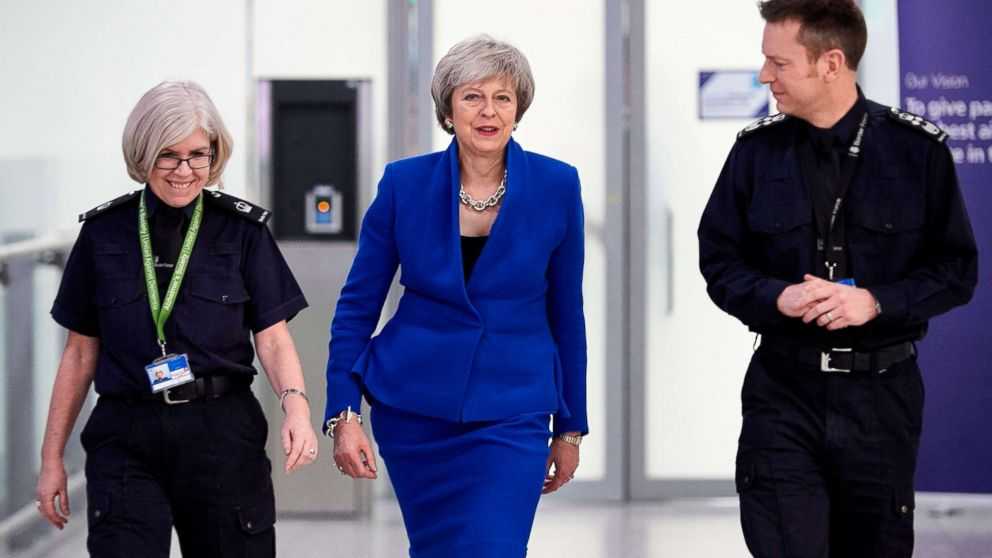 Britain's Prime Minister Theresa May talks with UK Border Force officers as she visits their Command Centre during her visit to Terminal 5 at London Heathrow Airport in west London on Dec. 19, 2018.