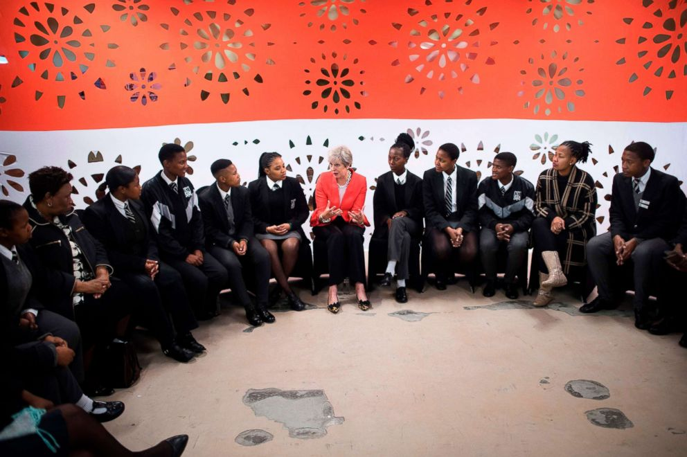 PHOTO: Britains Prime Minister Theresa May talks to a group of school children during a visit to the ID Mkhize Secondary School in Gugulethu, as part of a working visit to South Africa, Aug. 28, 2018.