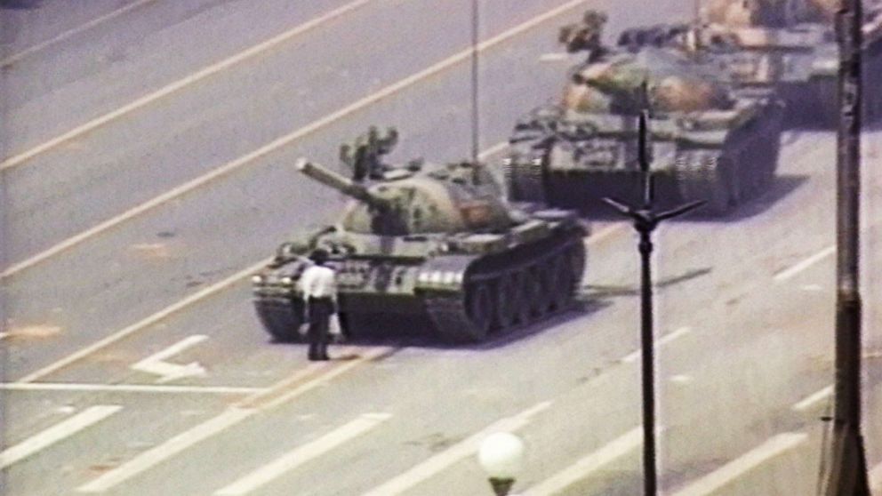 PHOTO: A lone demonstrator stands down a column of tanks, June 5, 1989, at the entrance to Tiananmen Square in Beijing.