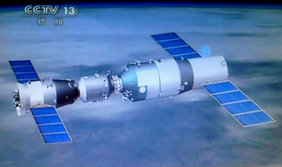 PHOTO: Chinas latest manned space capsule docked with the space lab, Tiangong-1 is seen in space in this June 13, 2013 TV grab.