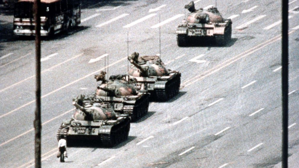 A Beijing demonstrator blocks the path of a tank convoy along the Avenue of Eternal Peace near Tiananmen Square, Beijing, on June 05, 1989.