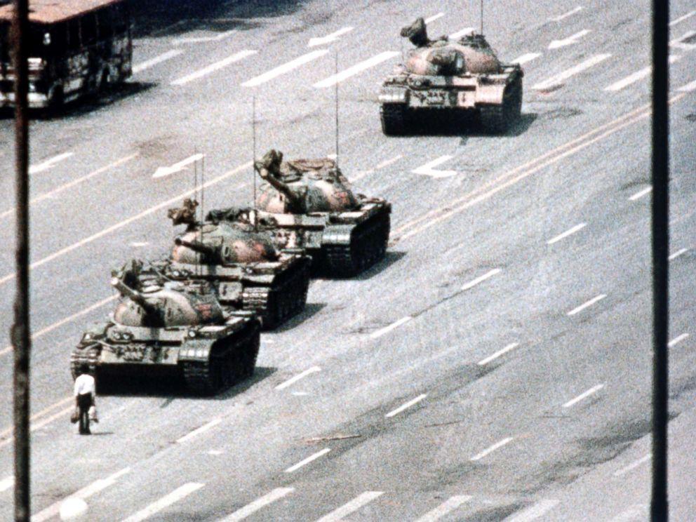 PHOTO: A Beijing demonstrator blocks the path of a tank convoy along the Avenue of Eternal Peace near Tiananmen Square, Beijing, on June 05, 1989.