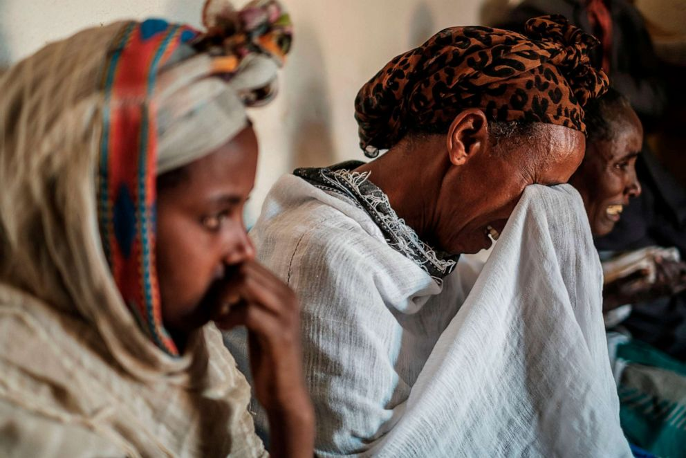 PHOTO: People mourn the victims of a massacre allegedly perpetrated by Eritrean Soldiers, at the house of Beyenesh Tekleyohannes, in the village of Dengolat, North of Mekele, the capital of Tigray on Feb. 26, 2021.