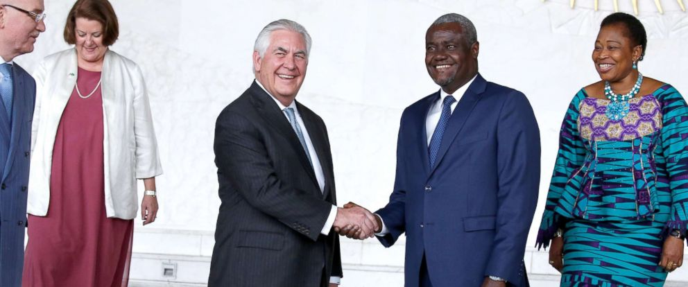 PHOTO: African Union (AU) Commission Chairman Moussa Faki, of Chad, and Secretary of State Rex Tillerson shake hands for photographers after their meeting at AU headquarters in Addis Ababa, Ethiopia, March 8, 2018.