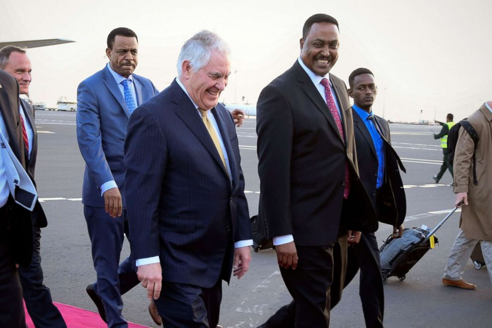 PHOTO: Secretary of State Rex Tillerson (L) smiles as he walks with Ethiopian Foreign Minister Workneh Gebeyehu (R) upon his arrival at the Bole International Airport in Addis Ababa, Ethiopia, March 7, 2018.