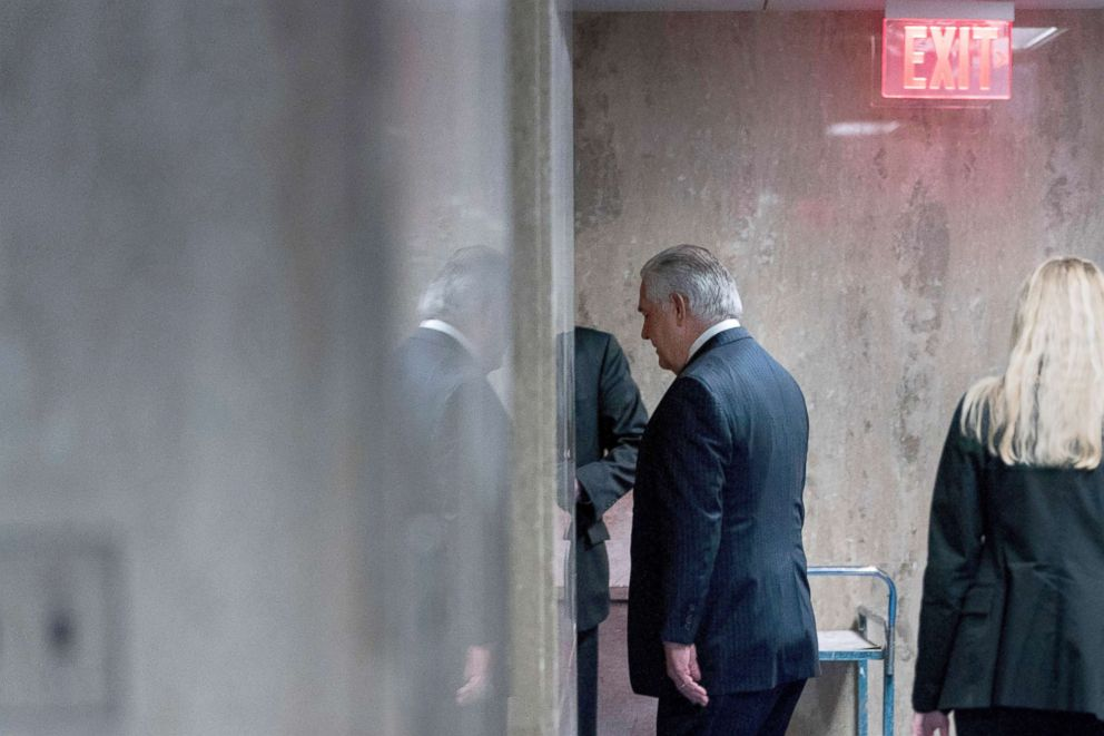 PHOTO: Secretary of State Rex Tillerson walks down a hallway after speaking at a news conference at the State Department in Washington, March 13, 2018.