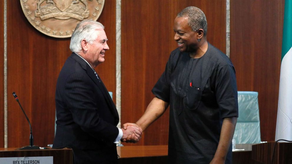 U.S. Secretary of State Rex Tillerson and Nigeria's Foreign Minister Geoffrey Onyeama shake hands after their news conference in Abuja, Nigeria, March 12, 2018.