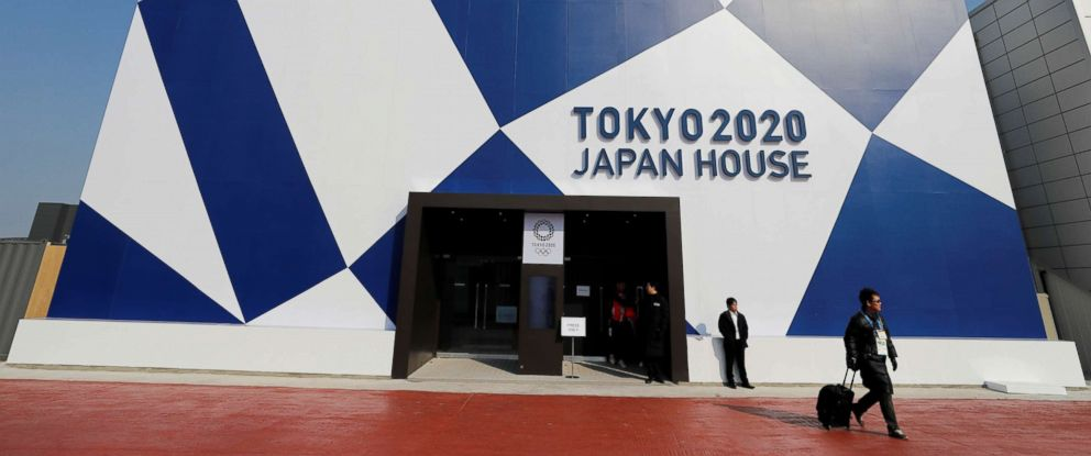PHOTO: A visitor leaves after attending the Tokyo 2020 Japan House during a media preview in Gangneung, South Korea, Feb. 8, 2018.