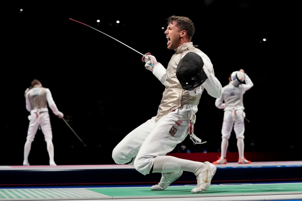 PHOTO: Alexander Choupenitch of the Czech Republic celebrates defeating Peter Joppich of Germany in the men's individual round of 16 Foil competition at the 2020 Summer Olympics, Monday, July 26, 2021, in Chiba, Japan.
