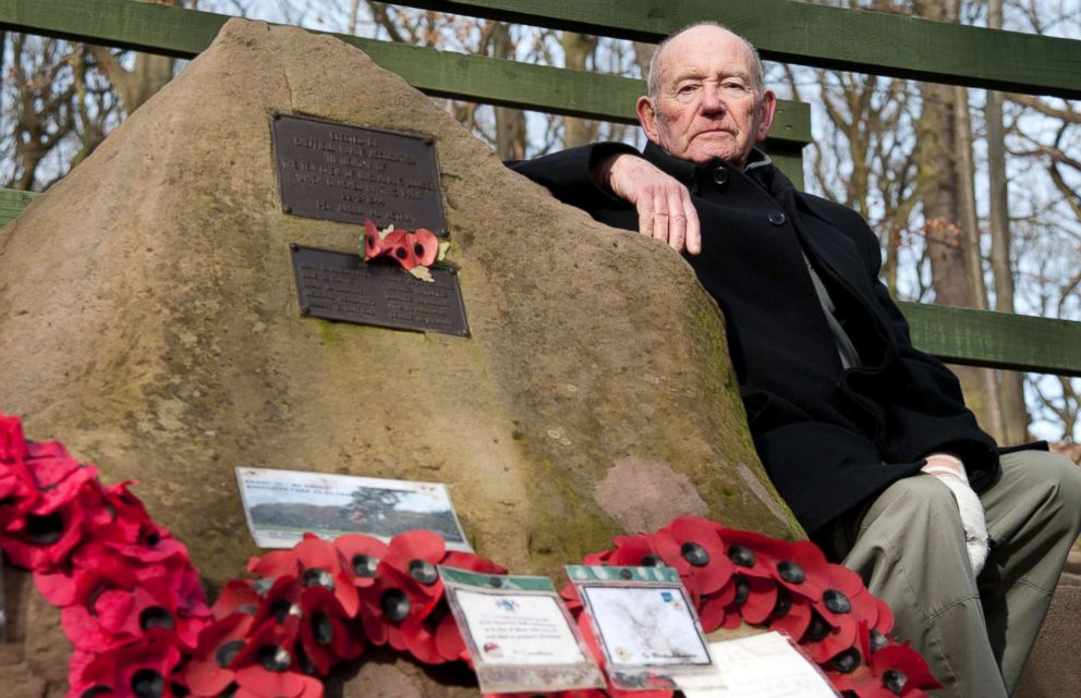 PHOTO: Tony Foulds sits next to a memorial honoring 10 U.S. airmen who died in a plane crash in 1944, in Endcliffe Park, Sheffield, England, Feb. 13, 2019.