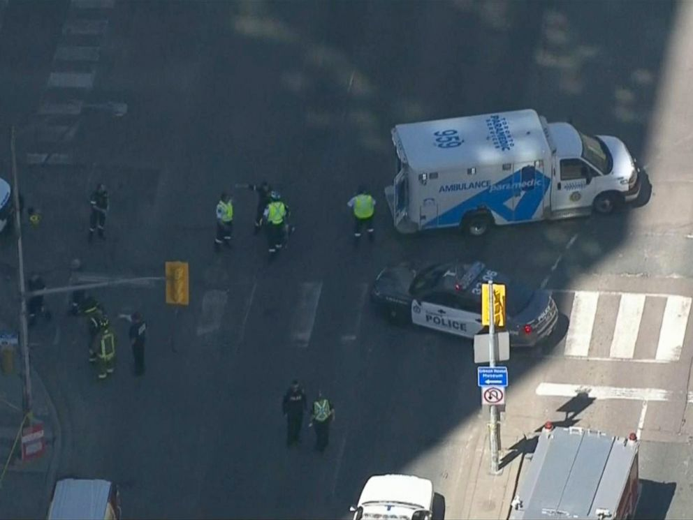 PHOTO: Police arrive on the scene where a white van struck pedestrians, April 23, 2018, in Toronto, Canada.