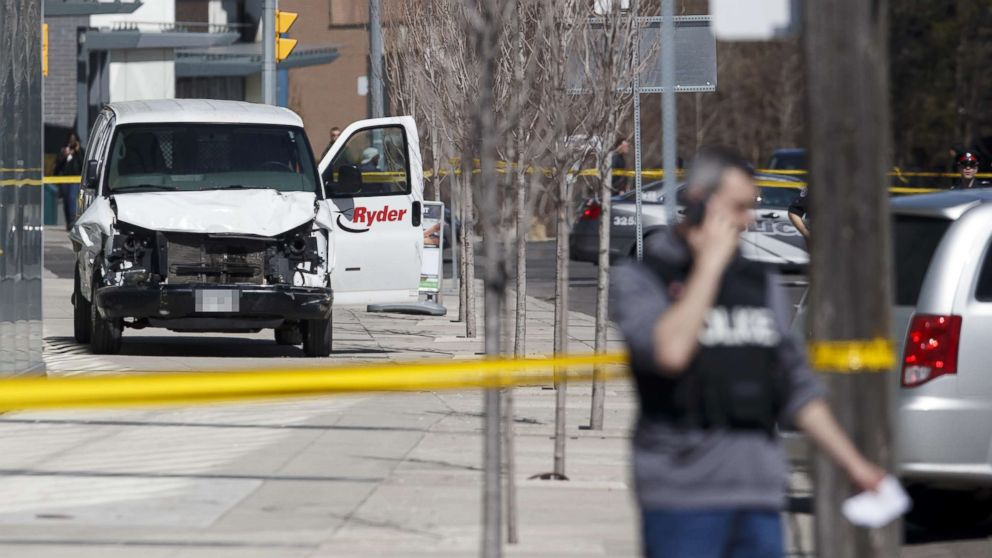 Police inspect a van suspected of being involved in a collision injuring at least eight people at Yonge St. and Finch Ave., April 23, 2018, in Toronto, Canada.