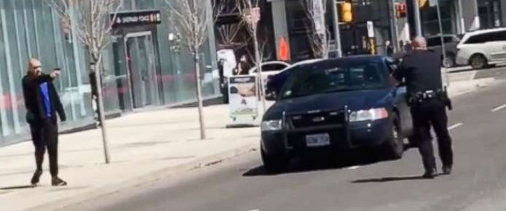 PHOTO: Video footage shows a police officer confronting the man who allegedly rammed into pedestrians with a van in Toronto, Canada, April 23, 2018.