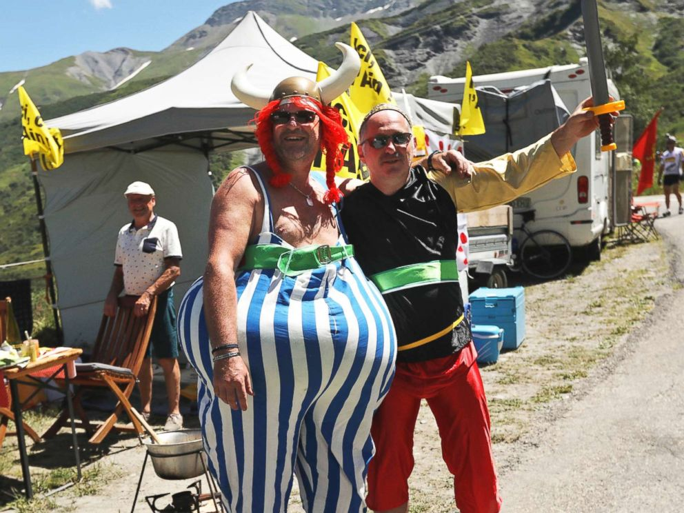 PHOTO: Two men dressed as French comics characters Asterix and Obelix line the road during the twelfth stage of the Tour de France cycling race over 109 miles with start in Bourg-Saint-Maurice Les Arcs and Alpe dHuez, France, July 19, 2018.