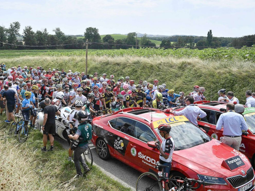 Tour de France stopped after protesters roll hay into the riders path
