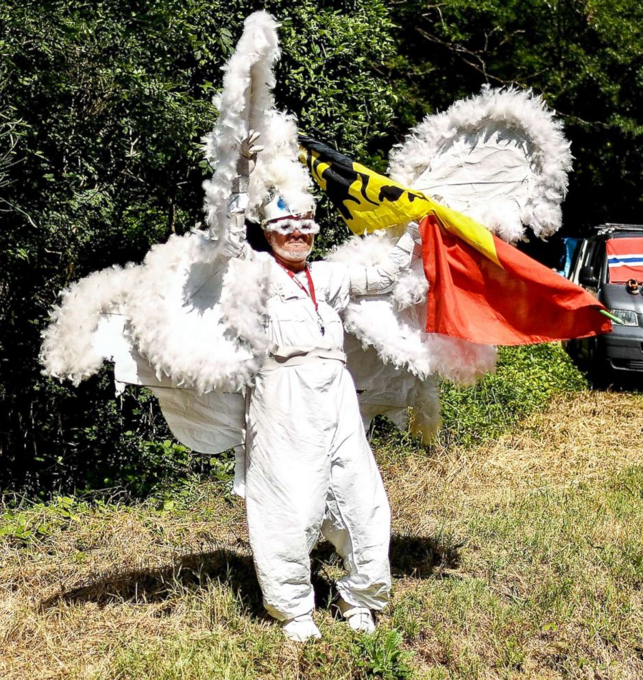 PHOTO: A spectator dressed in a fancy costume waves from the side of the route during the 15th stage of the 105th edition of the Tour de France cycling race, between Millau and Carcassonne, July 22, 2018.