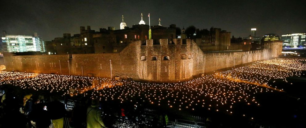 """PHOTO: The moat of the Tower of London are seen filled with thousands of lit torches as part of the installation """"Beyond the Deepening Shadow,"""" in London, Nov. 4, 2018."""