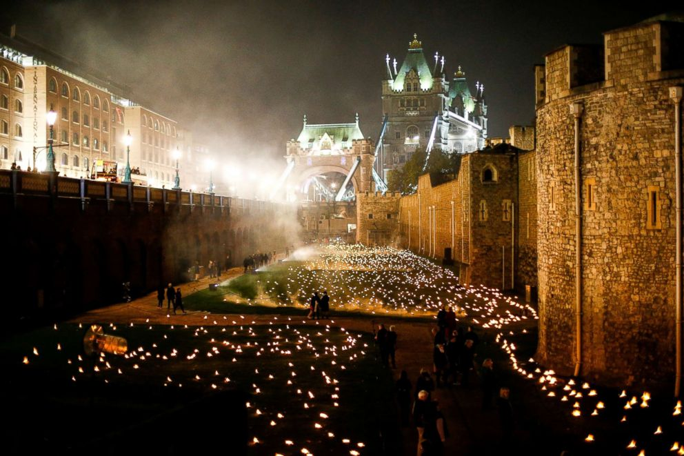 PHOTO: The moat of the Tower of London are seen filled with thousands of lit torches as part of the installation Beyond the Deepening Shadow, in London, Nov. 4, 2018.