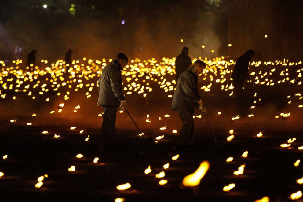 PHOTO: People light thousands of flames in a lighting ceremony at the Tower of London, Nov. 4, 2018, as part of an installation called Beyond the Deepening Shadow: The Tower Remembers, marking the end of the First World War.