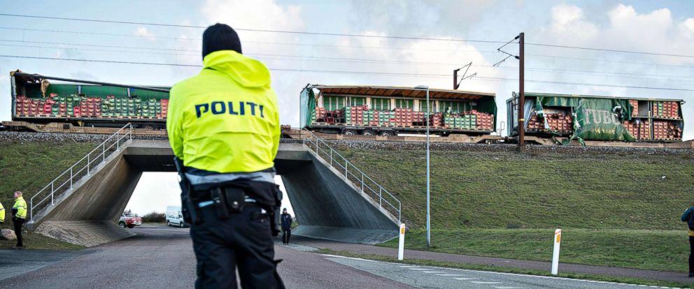 PHOTO: A police officer looks on near a damaged cargo train compartment near the Storebaelt bridge, near Nyborg in Denmark, Jan. 2, 2019.