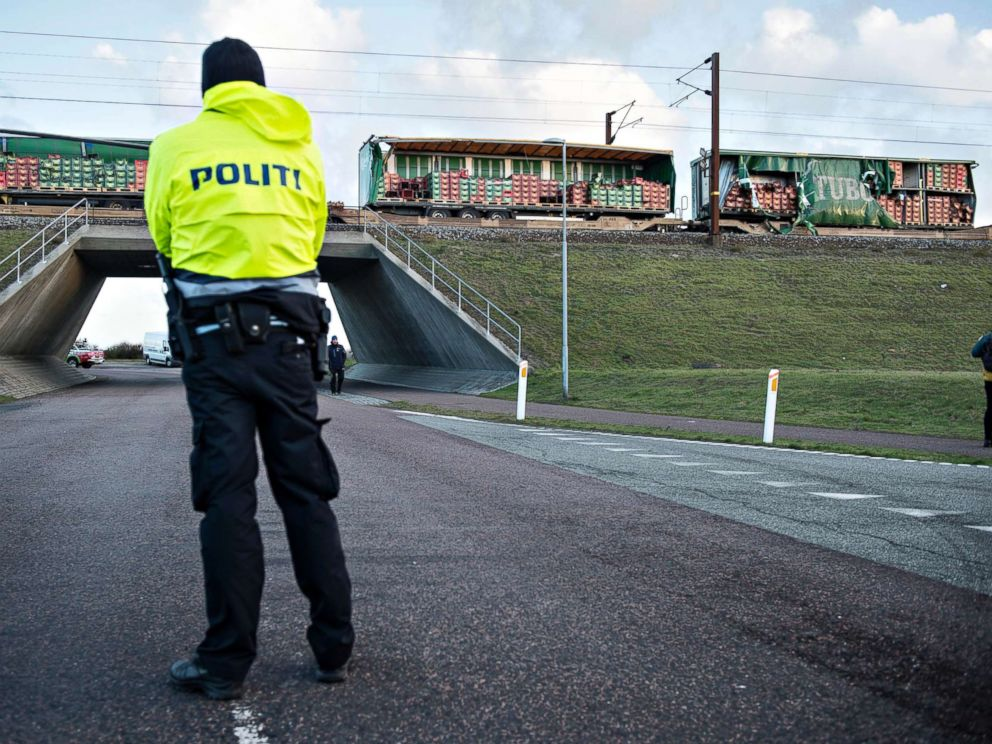 PHOTO: A police officer looks on near a damaged cargo train compartment near the Storebaelt bridge, near Nyborg in Denmark, Jan. 2, 2019.