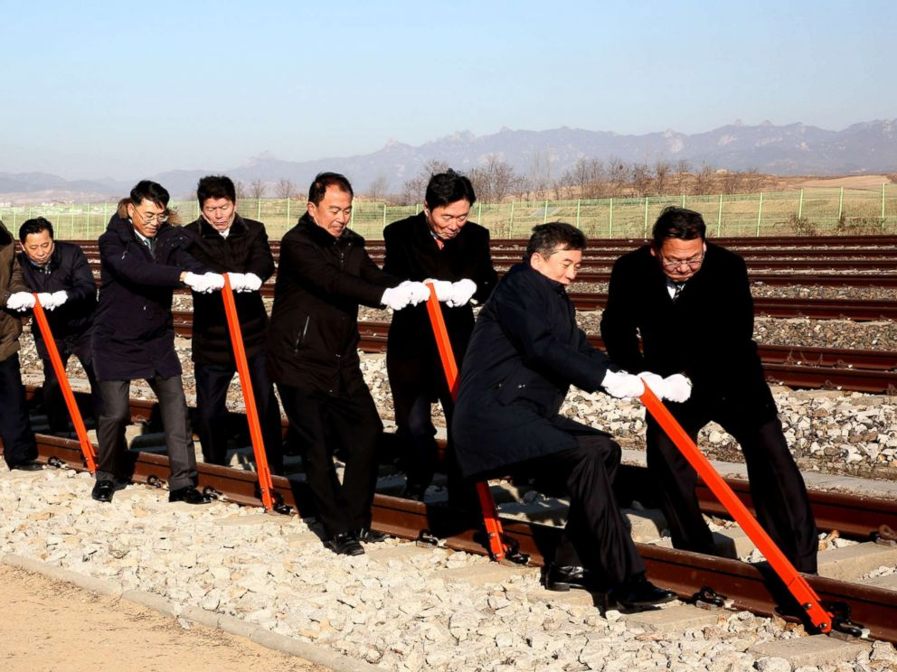 PHOTO:South and North Koreas officials try to connect the railroad during the ceremony for a project to modernize and connect roads and railways over the border between the Koreas at Panmun Station, Dec. 26, 2018, in Kaesong, North Korea.