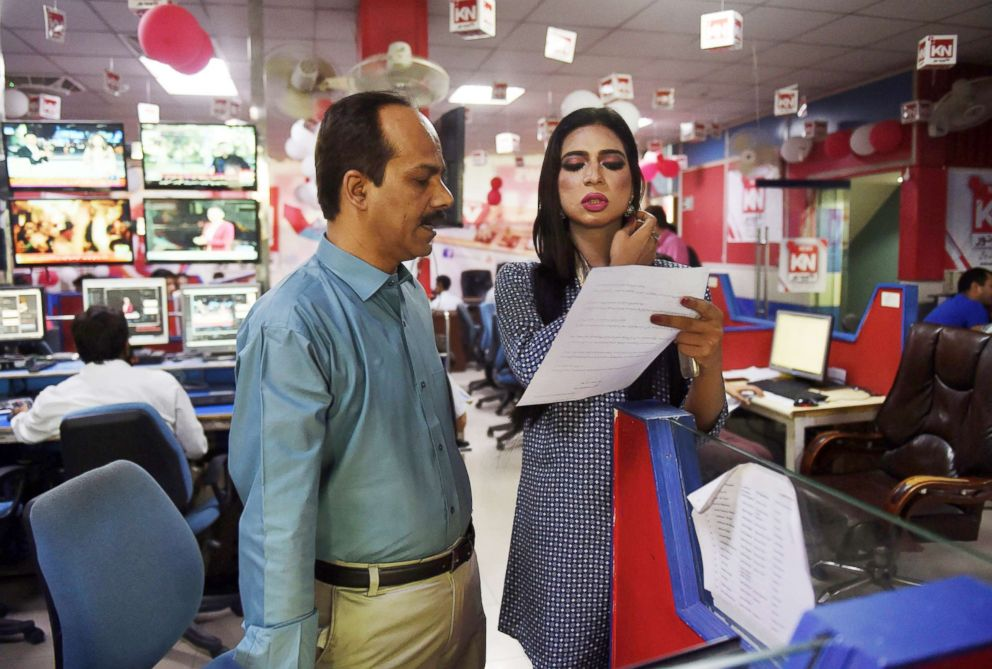 PHOTO: Pakistans first transgender news anchor Marvia Malik, 21, speaks with copy editor Pervez Ahmad before reading the news on air for private channel Kohenoor in Lahore, March 27, 2018.