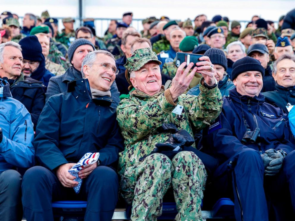 PHOTO: NATO Secretary General Jens Stoltenberg and Commander of NATOs Joint Force Command Naples, US Admiral James G Foggo pose for a selfie during a visit at the NATO-led military exercise Trident Juncture in Trondheim, Norway, Oct. 30, 2018.