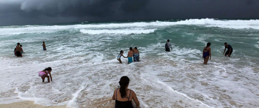 PHOTO: People swim at a beach in Cancun, Mexico, Oct. 7, 2018. The tropical depression that was moving to Florida through the Gulf of Mexico has turned into tropical storm Michael, the National Hurricane Center (NHC) reported.