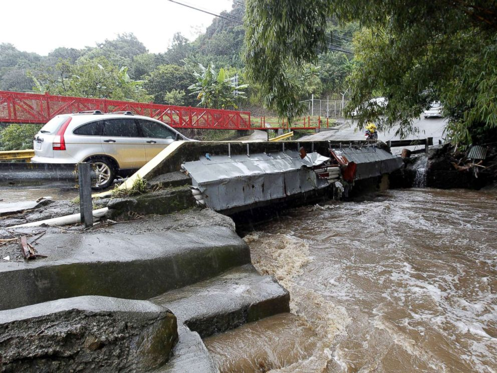 PHOTO: A vehicle crossing a bridge over a high river due to hard rains in Sabanilla area in Alajuelita, Costa Rica, Oct. 5, 2017.