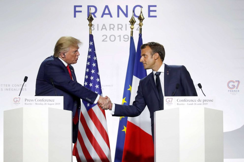 PHOTO: President Donald Trump shakes hands with French President Emmanuel Macron during a joint press conference at the end of the G7 summit in Biarritz, France, Aug. 26, 2019.