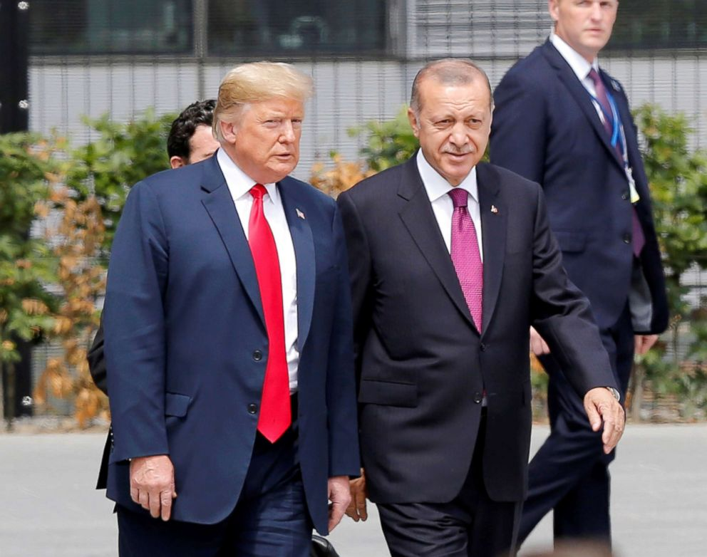 PHOTO: Turkish President Recep Tayyip Erdogan, right, and President Donald Trump speak to each other during the 2018 NATO Summit at NATO headquarters, July 11, 2018, in Brussels, Belgium.